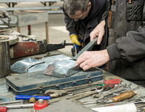 Workers with sheet metal stock images