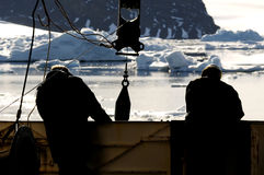 Workers on ship in Antarctica Stock Image