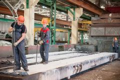 Workers in shop of steel concrete panels Royalty Free Stock Photo