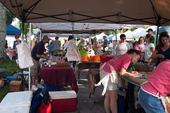 Workers and Shoppers at Outdoor Farmer�s Market Royalty Free Stock Photography