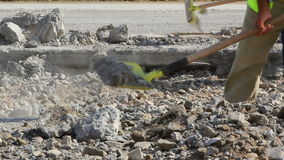 Workers shoveling on a runway construction site stock footage