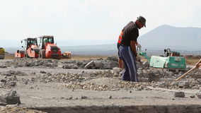 Workers shoveling on a runway construction site stock video footage