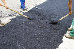 Workers with shovels scatter asphalt Stock Photo
