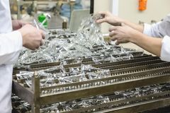Workers sorts production on pharmaceutical industry manufacture Stock Photo