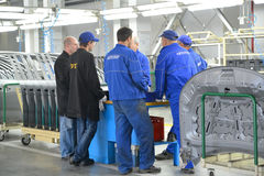 Workers and staff of Quality Department discuss problem points i. N work. Shop of automobile plant Royalty Free Stock Photography