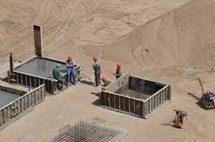 Workers standing at construction site having a conversation during pause stock photos