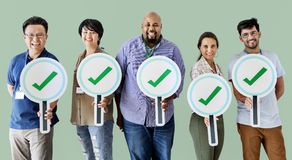 Workers standing and holding correct ticks logos Stock Photos