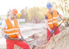 Workers standing with shovels Royalty Free Stock Photo