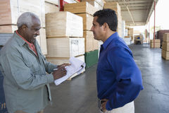 Workers Standing In The Warehouse Stock Photography
