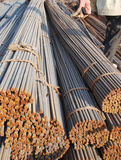 The workers and steel bar bundle Royalty Free Stock Photos