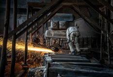 The workers in the steel mill are burnishing the steel royalty free stock image