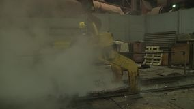 Workers on steel plant operates with molten metal. Copper plant stock video