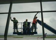 Workers of steeplejack washing windows Stock Photo