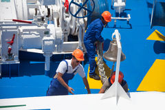 Workers at the stern of the liner. During the day in summer work stock image