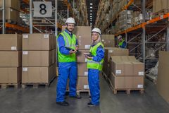 Warehouse workers looking at camera Stock Image