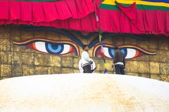 Workers on the stupa Boudhanath during festive solemn Puja Royalty Free Stock Images