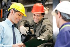 Workers And Supervisors At Warehouse Stock Images