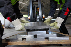 Workers taking aluminium billet Royalty Free Stock Images