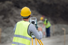 Workers with theodolite Stock Photo