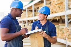 Workers timber yard. Two male hardware store workers working in timber yard Stock Photos