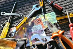 Workers tools and Australian dollars Stock Photo