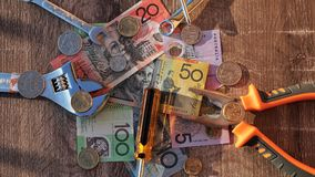 Workers tools and Australian dollars stock photography