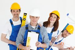 Workers with tools and contract stock images