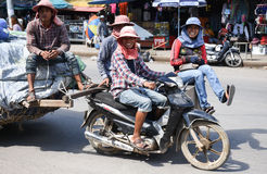 Workers transport goods by motorbike and cart Stock Photo