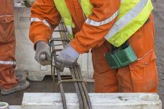 Workers tying rebar Stock Photo
