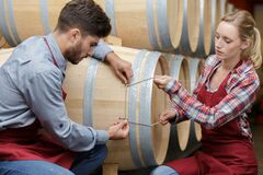 Free Workers Tying Up Barrel Royalty Free Stock Images - 218002359