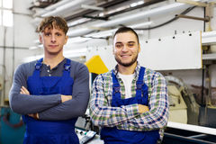 Workers in uniform at  industry plant Royalty Free Stock Photography