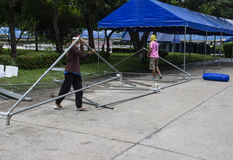 The workers are uninstalling the big tent in front of Chiangmai Royalty Free Stock Image