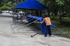 The workers are uninstalling the big tent in front of Chiangmai Royalty Free Stock Photos