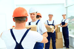 Workers unload boxes Stock Photo