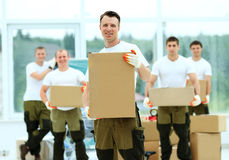Workers unload boxes Royalty Free Stock Photos