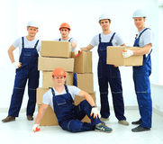 Workers unload boxes Stock Photos