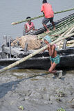 Workers unload cargo from the boat in Gosaba, India Stock Photos