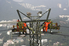 Workers Up High on Crane. Crane workers with view of the skyline of Hong Kong royalty free stock images