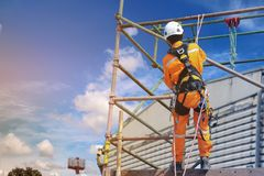 Safety harness. Workers up high with safety equipment and safety belts Safety harness on blue sky background Stock Photo