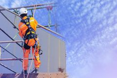 Safety harness. Workers up high with safety equipment and safety belts Safety harness and The harness is an attachment between a stationary and non-stationary Royalty Free Stock Image