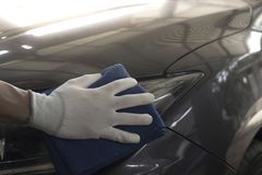 Workers use car wipes. Take care of your car royalty free stock image