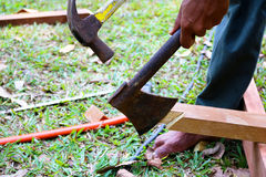 Workers use a hammer smashed the axe. Stock Photos