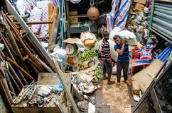 Workers at the used things market place at Male. Maldives. Royalty Free Stock Photo