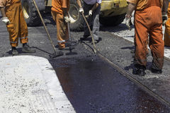 Workers using a asphalt tool to spread mastic asphalt 3 Stock Photos