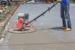 Workers are using concrete polishing machines for cement after Pouring ready-mixed concrete stock photography