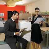 Workers using copy machine iol Royalty Free Stock Image