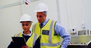 Workers using digital tablet stock footage