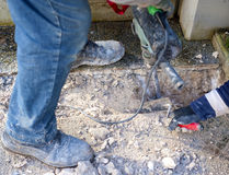 Workers using Jackhammer and trowel Stock Photos