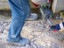 Workers using Jackhammer and trowel Stock Photo