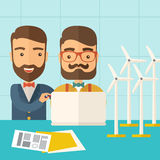 Workers using laptop with windmills. Stock Photo